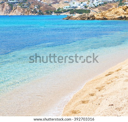 in      greece  the mykonos island rock sea and beach    sky