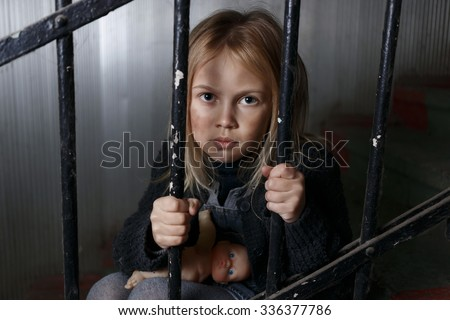 In jail of destiny. Poor sad hopeless girl sitting on the staircases and holding handrail while feeling depressed - stock photo