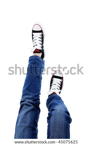 In jeans and sneakers over white background. - stock photo