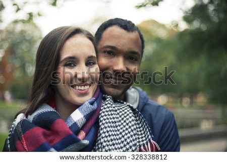 In Love Interracial couple in a park - stock photo