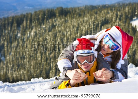 In love pair on ski vacation - stock photo