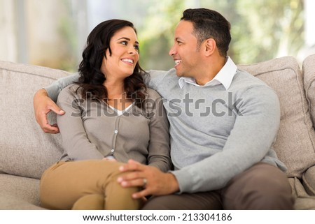in love young couple looking at each other at home - stock photo