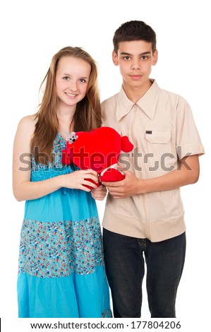 In love young couple with a heart isolated