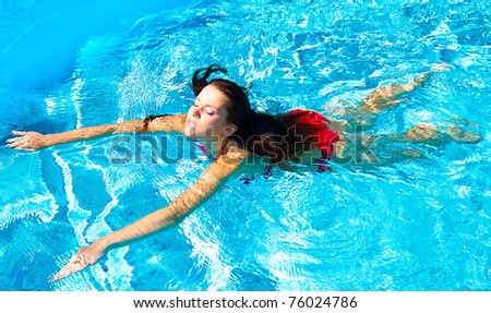 in Luxury by a Pool Posing - stock photo