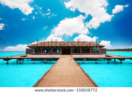 In Maldives. A beach house floating on the water. - stock photo