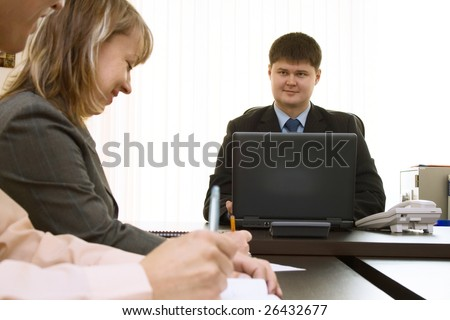 In office working manager for laptop and secretary in office for the table