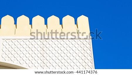 in oman the wall of big muscat mosque - stock photo