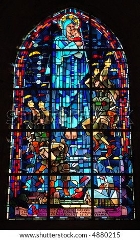In Sainte-Mere-Eglise church, two stained glass windows commemorate liberation of the town on 6 June 1944, by the 82nd Airborne para-chutists. - stock photo
