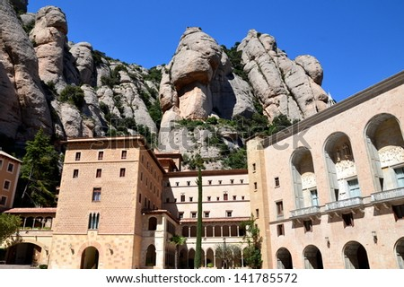 in Spain, near Barcelona, the Santa Maria benedictine monastery of Montserrat is situated in a spectacular site mountainous; The pilgrims come to Montserrat to worship the statue of the black virgin. - stock photo