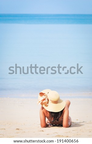In summer time. Happy woman with hat playing on the beach - stock photo