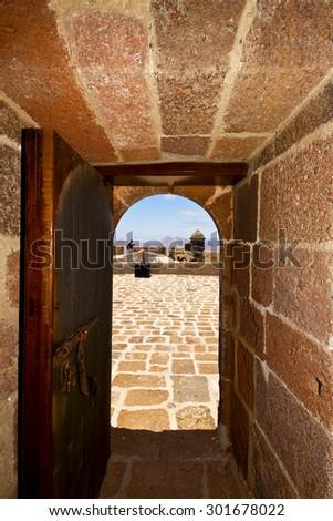 in teguise arrecife lanzarote castillo de las coloradas spain the old wall castle  tower and door  - stock photo