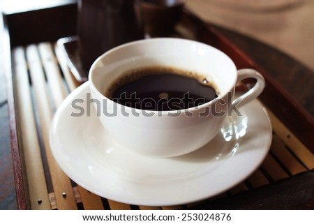 In the afternoon, black coffee, White cup ,soft relaxing.