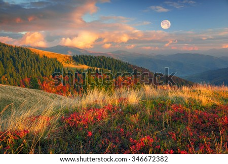 In the Carpathians, golden autumn cold often turns into snow, and then again come warm sunny days. Against the background of high mountain ranges and beautiful beech forests scenic - stock photo