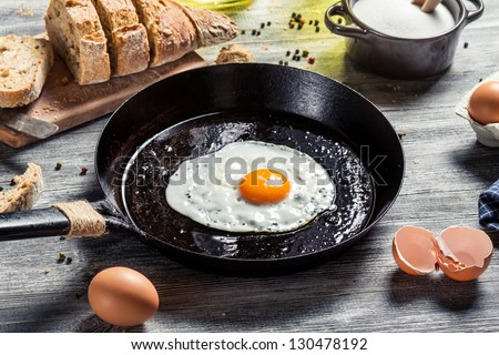 In the course of making breakfast with fresh eggs - stock photo