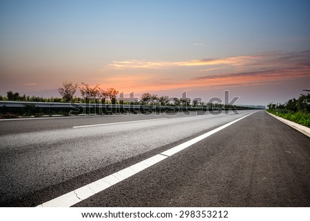 In the evening, empty highway - stock photo
