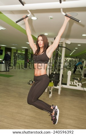 In the gym - girl is exercising in the gym  - stock photo