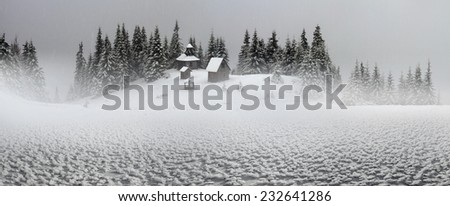 In the highest mountains of Ukraine, including steep slopes seekers Adventure and Travel- winter tourists can find a lonely monastery with the church, lost in the vast expanses of Chornogory - stock photo