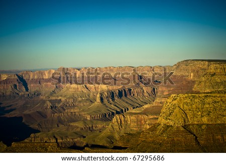 In the late afternoon the light and shadows alter the way the grand canyon appears from one minute to the next. - stock photo