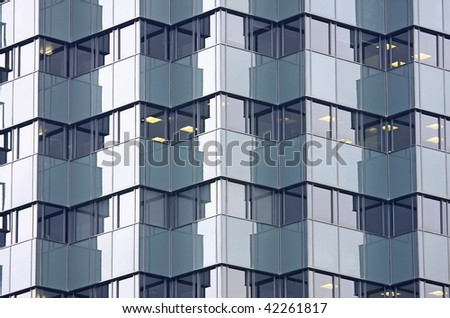 In the modern office building thousands of people working - stock photo