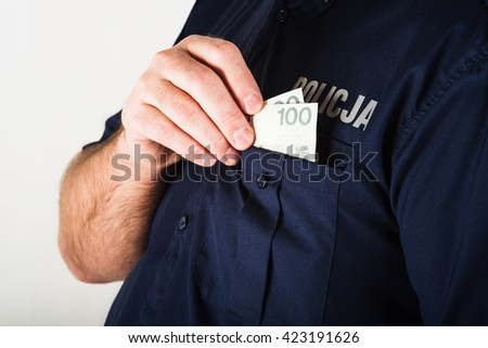 In the picture a corrupt policeman taking bribe - stock photo