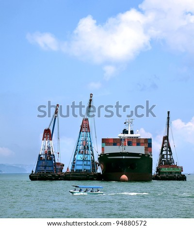 In the seaport containers loaded on a ship - stock photo