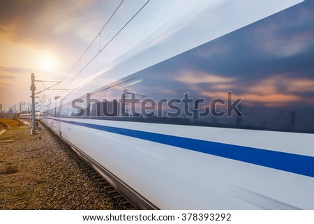In the Shanghai Railway Station, the modern and fast commuter train running - stock photo