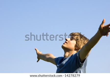 In tune with nature. Young boy showing happiness - stock photo