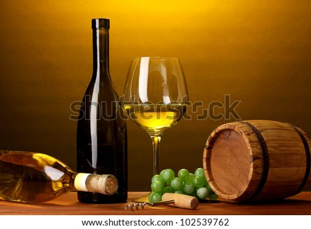 In wine cellar. Composition of wine bottle and runlet - stock photo