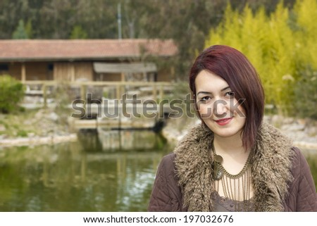 In wooded areas, streams and front of house, portrait lady who pose