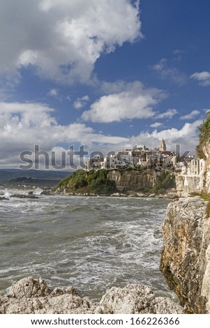 inaccessible coves, wild cliffs and many caves dominate the landscape of the Gargano coast - stock photo