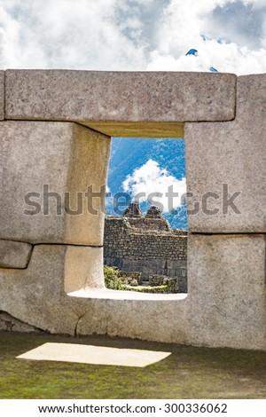Inca Ruin through Inca's window ,Machu Picchu, New 7 Wonder of the world, Cusco, Peru ( Focus on Inca ruin ) - stock photo