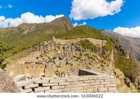 Inca Wall in Machu Picchu, Peru, South America. Example of polygonal masonry. The famous 32 angles stone in ancient Inca architecture.