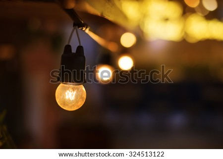Incandescence bulbs with noise and grain, shallow depth of field, selective focus (detailed close-up shot) - stock photo