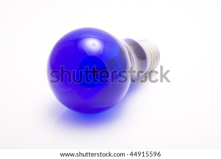 Incandescent bulb blue on a white background - stock photo