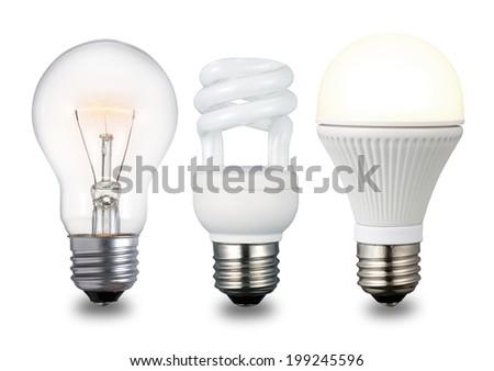Incandescent lightbulb, compact fluorescent lamp & LED lightbulb in ascending chronological order. Isolated on a white background. - stock photo