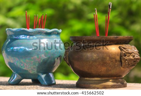 incense burner with lion statue - stock photo