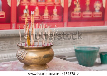 Incense is burned in the Chinese temple. - stock photo