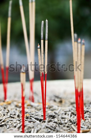 Incense sticks in ashes bucket - stock photo