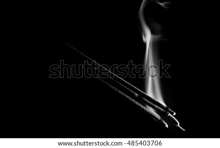 incense with low key lighting, dramatic faith religion fine art with black and white tone