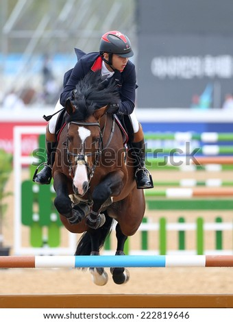 INCHEON - SEP 28:CHENG Man Kit of Hong Kong, China in action during the 2014 Incheon Asian Games at Dream Park Equestrian Venue on September 28, 2014 in Incheon, South Korea.