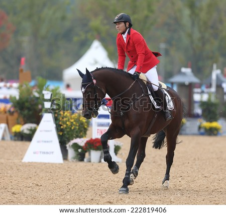 INCHEON - SEP 28:HUANG Po Hsiang of Chinese Taipai in action during the 2014 Incheon Asian Games at Dream Park Equestrian Venue on September 28, 2014 in Incheon, South Korea.
