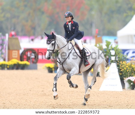 INCHEON - SEP 28:LERTRATANACHAI Sailub of Thailand in action during the 2014 Incheon Asian Games at Dream Park Equestrian Venue on September 28, 2014 in Incheon, South Korea.