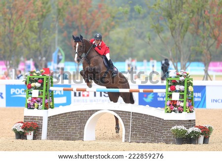 INCHEON - SEP 28:UTSUNOMIYA Takashi of Japan  in action during the 2014 Incheon Asian Games at Dream Park Equestrian Venue on September 28, 2014 in Incheon, South Korea.