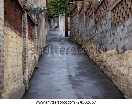 Incline pathway by old wall. - stock photo
