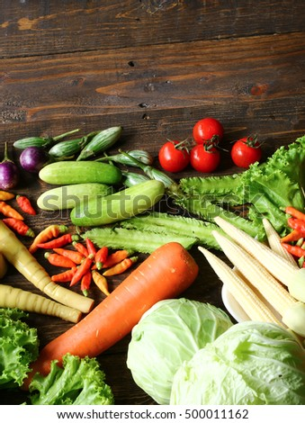 Include fresh organic vegetables on wooden floor with copy space still life