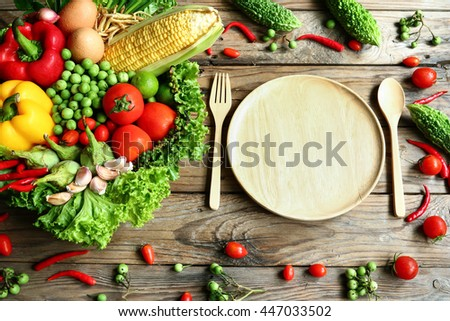 Include fresh vegetables on wooden floor with copy space