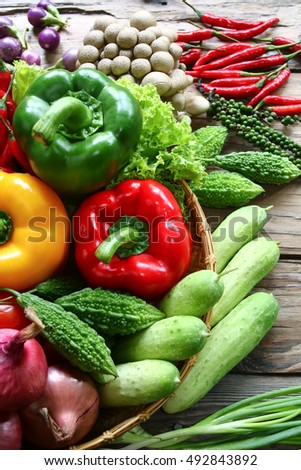 Include vegetables in basket on wooden floor with copy space