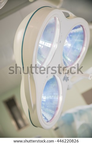 included bright lighting lamp the operating room in a hospital - stock photo