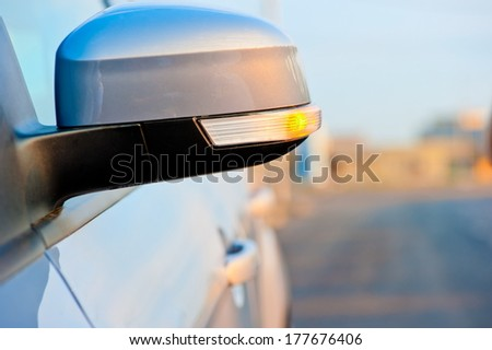 included in the side mirror turn signal - stock photo