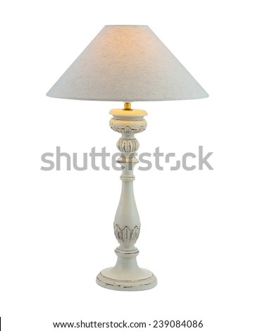 Included table lamp with shade on a wooden leg - stock photo